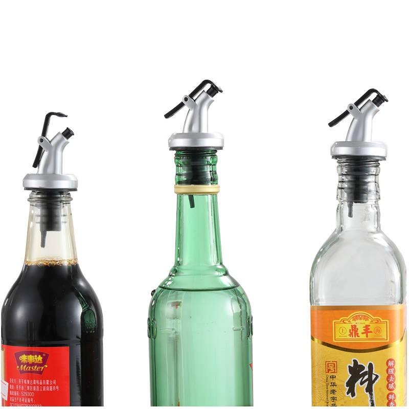 油の瓶の口は一滴も油の口の調味料の瓶のシリカゲルを抜かさないで、オリーブの瓶の口の瓶のふたの油の瓶の口を塞ぎます。