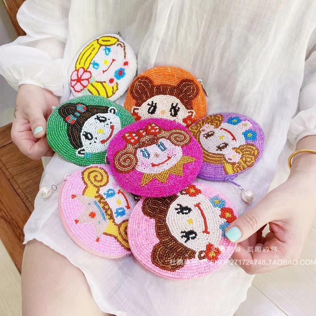 杜鹃珠绣新品原创设计手工卡通少女娃娃圆形硬币袋串珠可爱零钱包