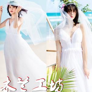 夏新款连衣裙海边度假风旅拍女装显瘦露背沙滩长裙性感飘逸轻婚纱