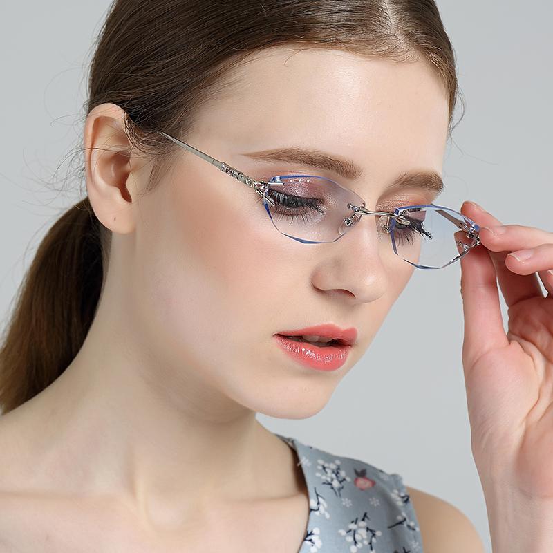 韓式の湿った金の水晶の切片の女性の金はダイヤモンドを象眼して縁がない眼鏡を切って近視の老眼鏡のフレームに配合します。