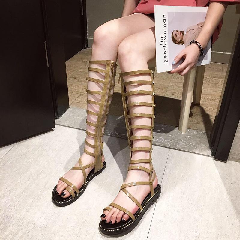 超高筒凉鞋女欧洲站2019夏季新款时尚套趾个性铆钉镂空平底罗马鞋