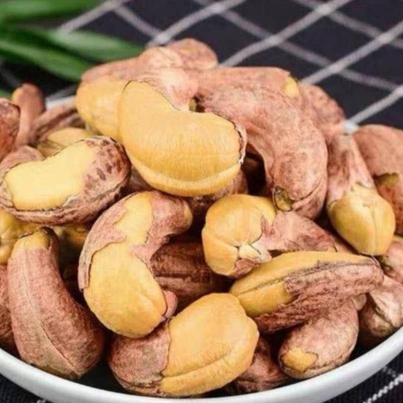 新商品の大きな粒は皮付きのナッツナッツとナッツの炒め物の塩焼きのカシューナッツのばら売り500 gが郵送されます。