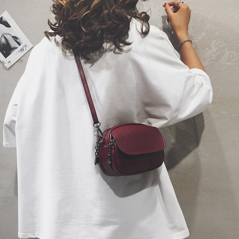 ミニミニミニポーチ女性ファッション2019新型レトロシンプルで、小円のバッグを肩から斜めに掛けた柔らかい皮の女性バッグです。