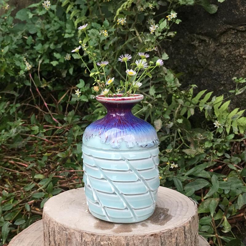 景徳鎮の手作り窯変流釉陶磁器の花瓶の花挿花器の新製品の陶芸彫刻跳刀の紋様は底がないです。