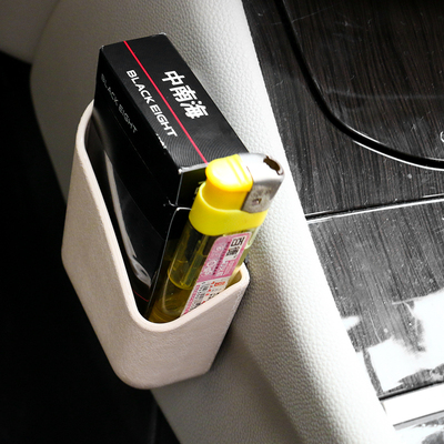 The car is equipped with a sticky storage box, in-car storage box, car multi-function air outlet, mobile phone storage box