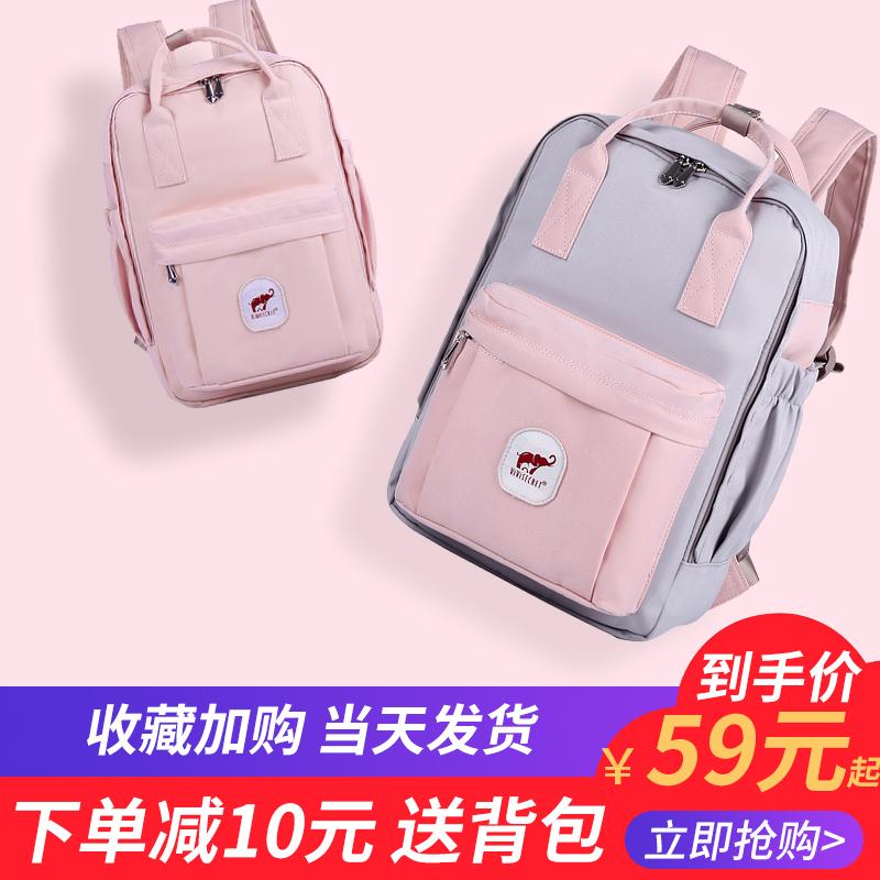 韩版甜甜圈双肩包女中小学生书包校园时尚百搭帆布旅行电脑背包男