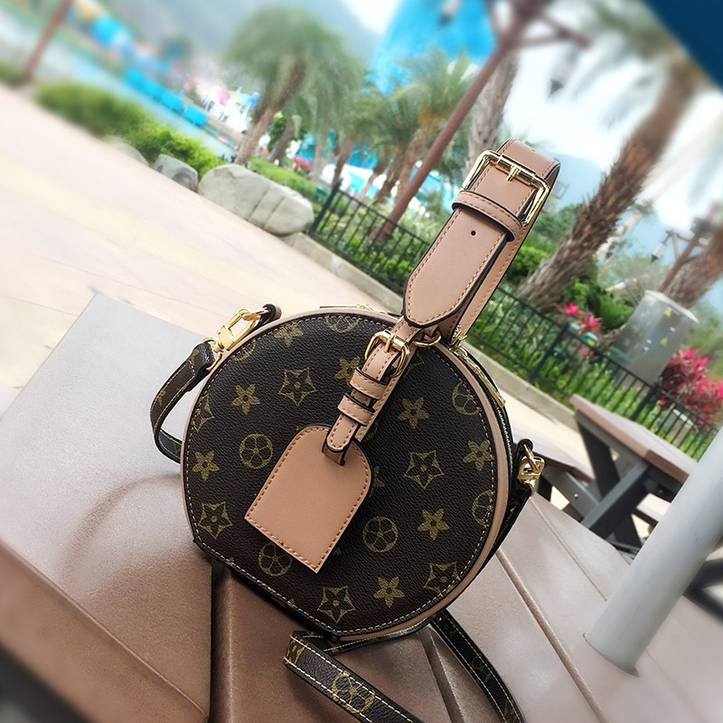 Aymi bag 2020 new fashion fashion texture retro small round bag womens single shoulder cross over Mini round bag