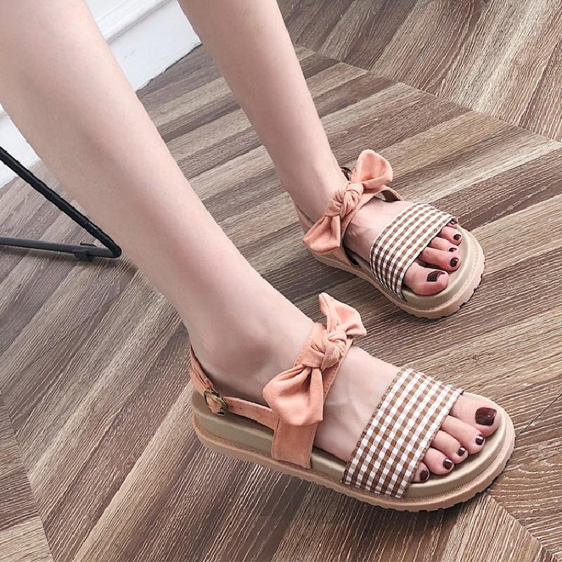 2018 new flat bottom soft girl bow sandals female summer student muffin thick bottom casual retro Roman shoes