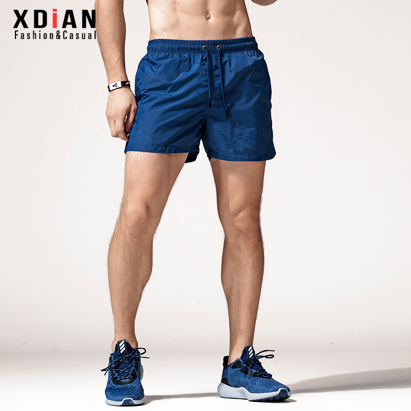 Sports shorts men's fast dry running 3-thirds pants fitness 4-thin casual trend summer wear beach pants