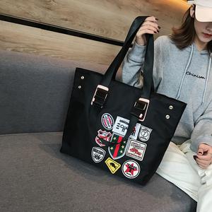 韩版女手提大包男单肩包防水牛津纺电脑包购物袋徽章大包行李袋