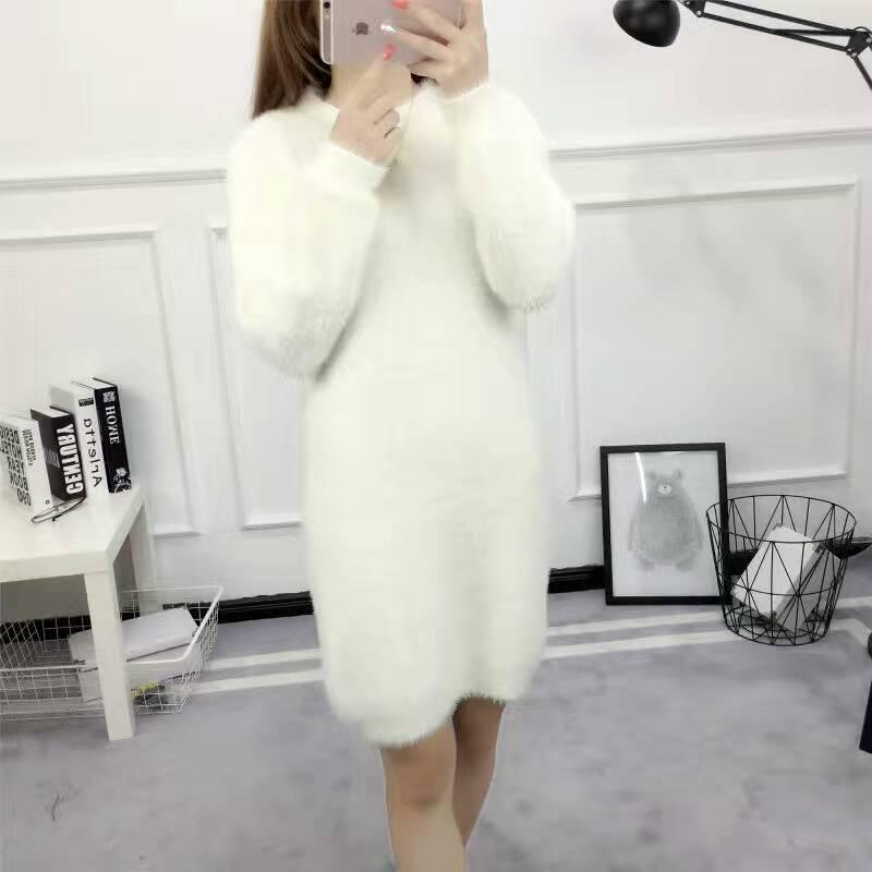 秋冬韓国バージョンの長袖の修身服のレオタードのスカートは尻の海馬のセーターのワンピースの中の長いタイプのボトムを包みます。
