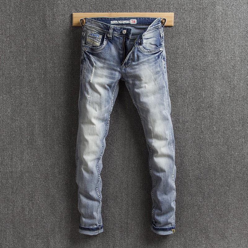 Spring and autumn new light blue European and American style simple Slim small straight tube jeans for men wear out white micro elastic youth
