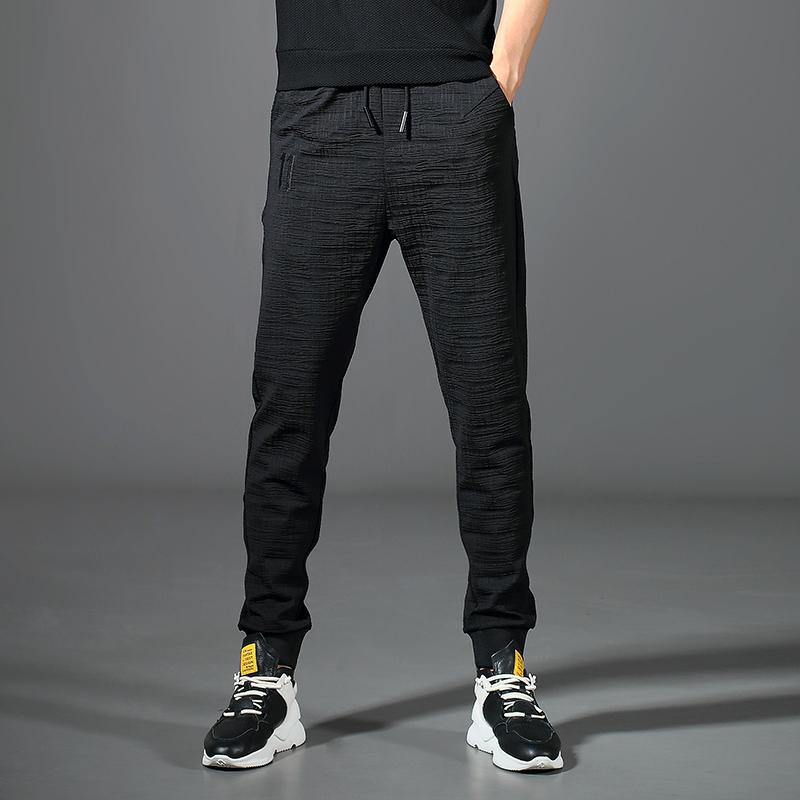 秋季新款褶皱立体格纹休闲裤男士束脚裤修身青年潮流弹力收口裤子