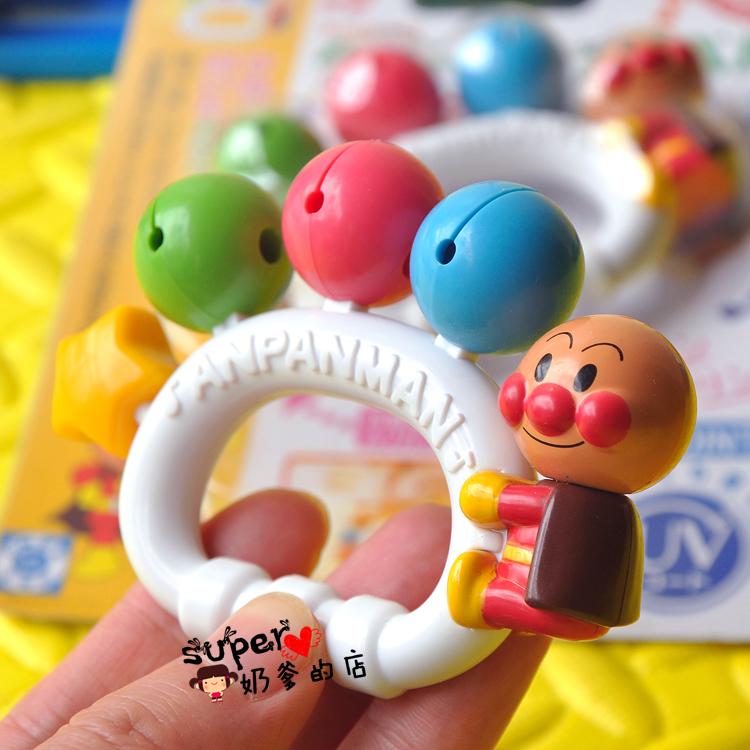Бесплатная доставка япония детские руки погремушки супермен рука колокол новорожденный ребенок успокаивать цвет игрушка 0-6 месяц