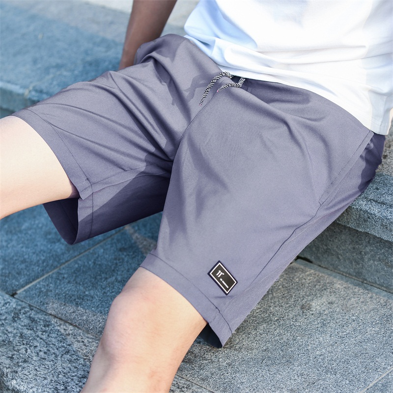 Summer casual pants mens shorts slim fit middle PANTS YOUTH beach pants sports Korean version 5-point pants 5-point trend