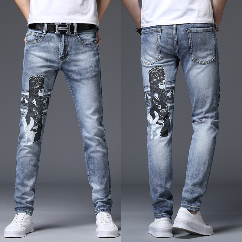 Stretch slim mens embroidered jeans with all kinds of head print personalized graffiti light blue legged mens pants
