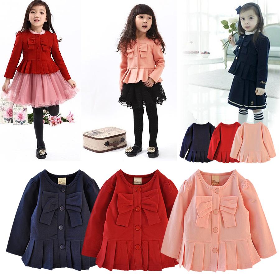 秋の子供服の韓国版の唯美の女の子のレースの蝶結びの短い上着のブラウス