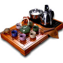 Dehua tea set Four tea tray solid wood tea sea and electric heating furnace A complete set of ceramic ceramic tea-pot group of kung fu