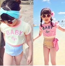Bought the new summer 2015 children swimwear girls fission of tall waist cuhk child is prevented bask in hot spring bathing suit with short sleeves