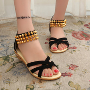 Spring new Korean version of Roman Sandals Women's beaded straps with flat bottom student women sandals
