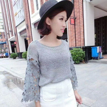Han Guodong door to hollow out splicing sleeve knit lace flowers fall on the new round collar pure color knitted blouse