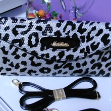 The new 2015 chun xia euramerican fashion boutique leopard hand bag One shoulder his mobile phone package dinner packages