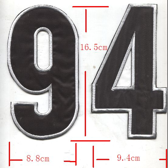 The back of the shirt is pasted with large digital cloth with white lines on black background