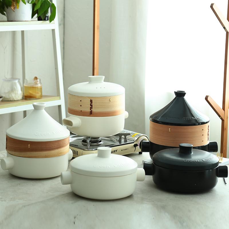 蒸し器を持っていて高温の石鍋の塔の吉鍋の蒸し器の白い土鍋のスープのシチューの鍋の陶磁器の鍋の調理器具に耐えます。