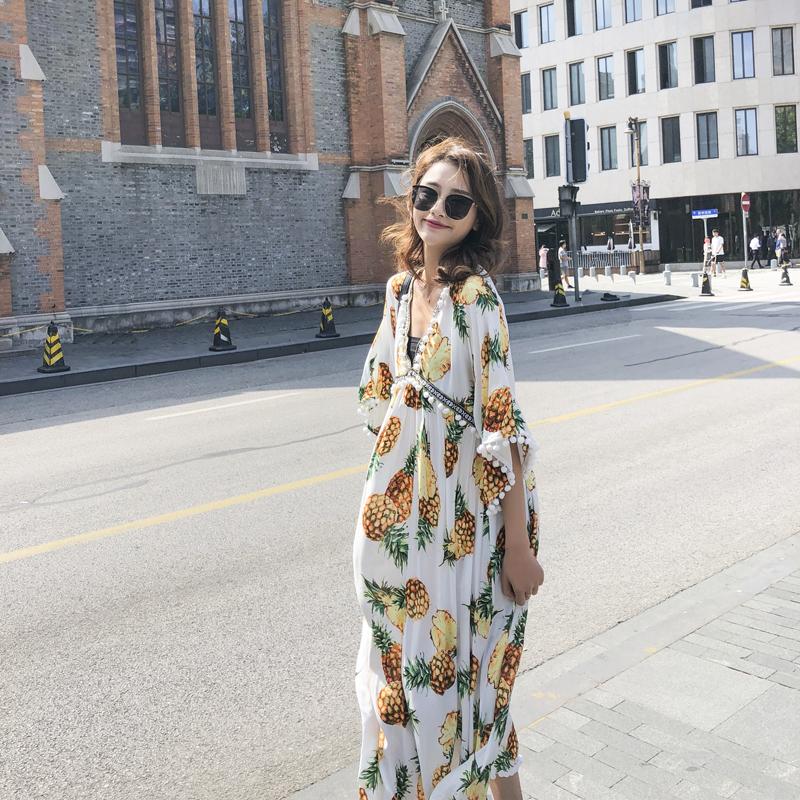 實拍2019春季新款V領蝙蝠袖寬松高腰度假海邊性感流蘇連衣裙長裙