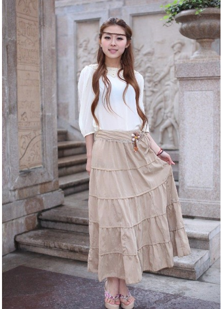 The new Korean high waist skirt in autumn and winter is versatile and thin. The cotton is sweet and artistic. The long skirt has a belt