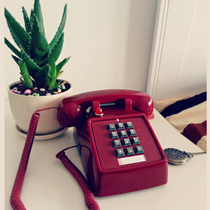 旧式のボタンは古いレトロな席機をまねて、アメリカの機械は鈴を振って創意的でファッション的な電話機の骨董品の電話機の25 T赤いです。