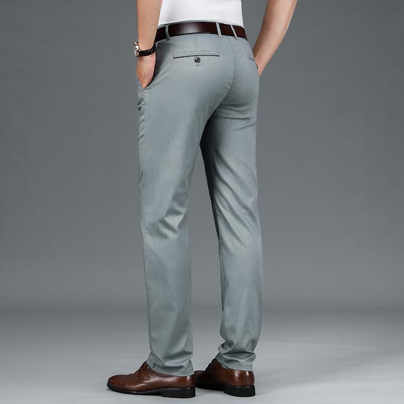 規格品のビジネスカジュアル男性のズボンの倉庫の柔らかい順の男性の支配人のズボンのブランドの特価の切断コードの清倉は旧式のまっすぐな筒を処理します