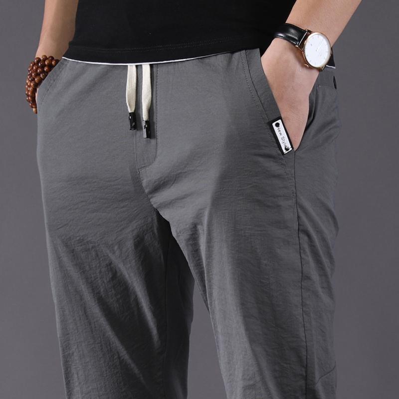 男裤子夏季薄款韩版潮流宽松修身小脚百搭运动超薄长裤男士休闲裤