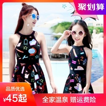A new swimsuit for girls  mother and daughter in flat angle bathing clothes a girl with a female skirt in a child-friendly swimsuit