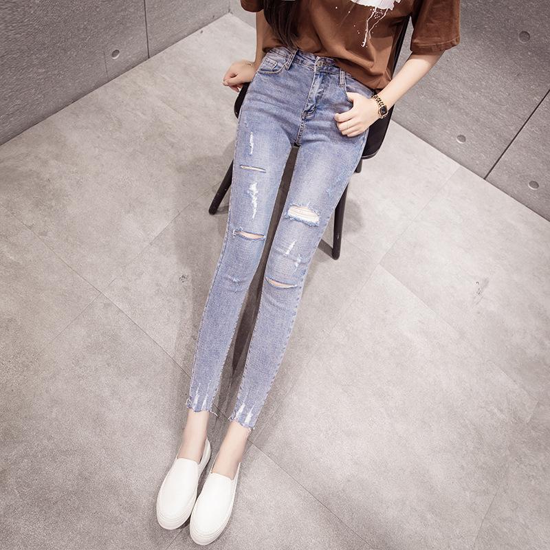 抖音同款2019春夏季新款浅蓝磨破时尚显瘦小脚棉弹牛仔裤女潮爆款