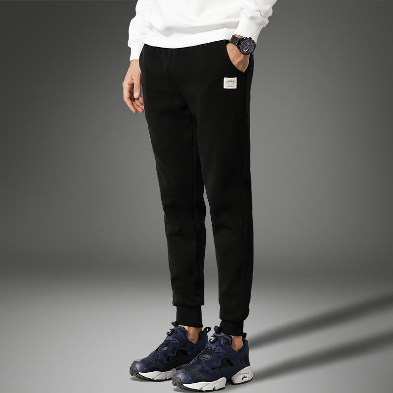 Осень и зима движение брюки мужчина тонкий пакет брюки утолщённый с дополнительным слоем пуха ноги девять очков харлан свободные большой размеров случайный брюки
