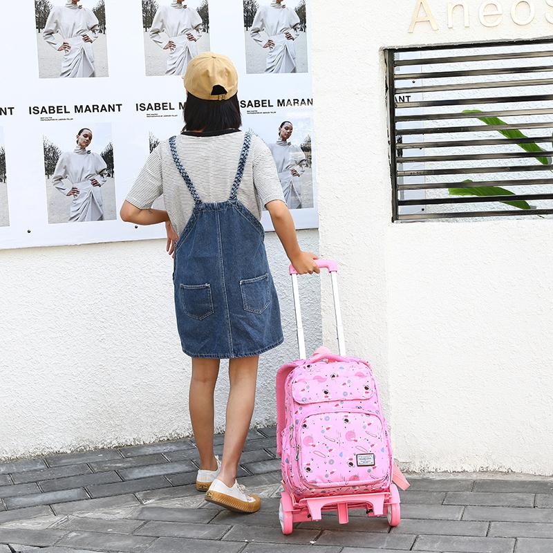 儿童手拖拉杆书包女小学生背两用中学生大容量可爬楼梯防水箱式架