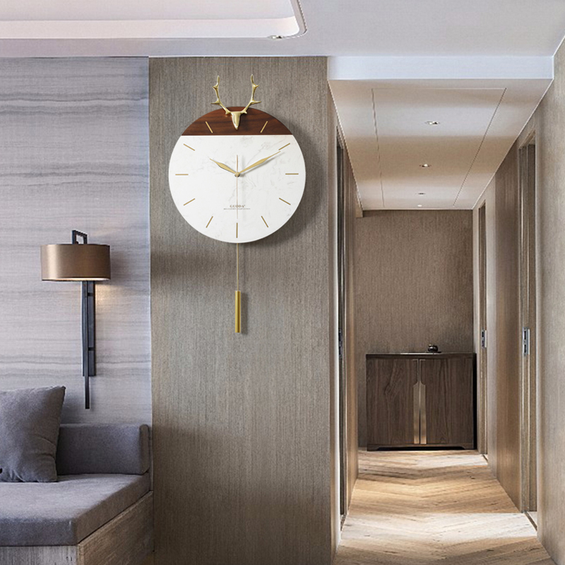 北欧鹿头铜挂钟客厅家用创意大理石简约钟表个性时尚挂墙挂表时钟