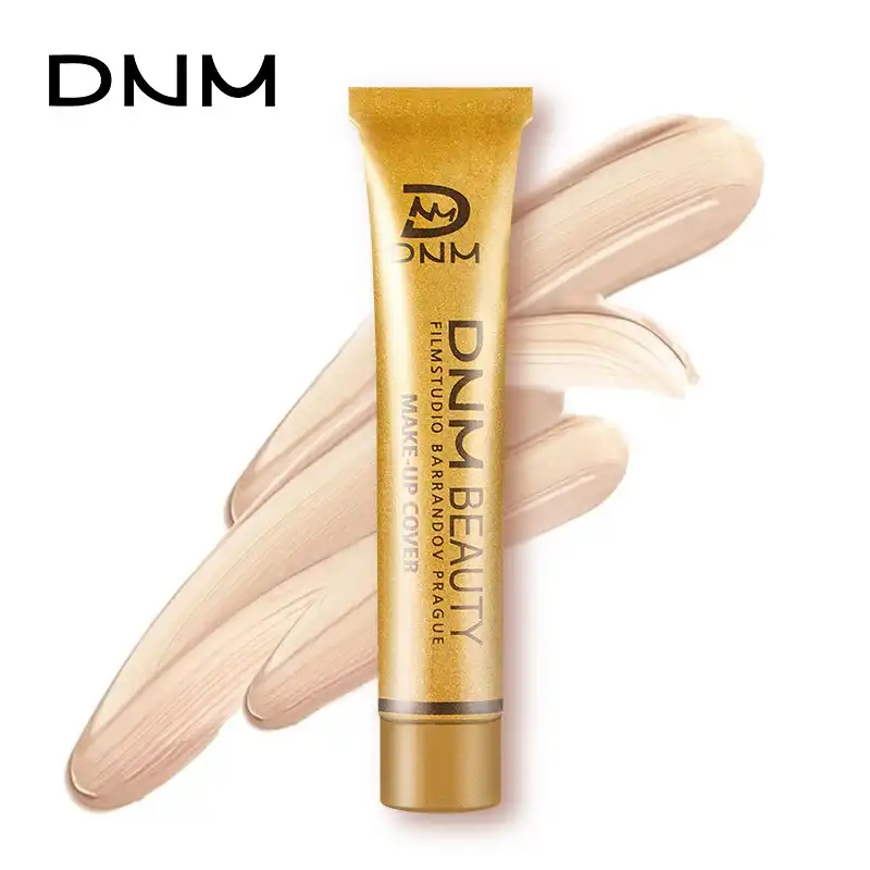 DNM small gold tube Concealer should be covered with long black and eye rings.