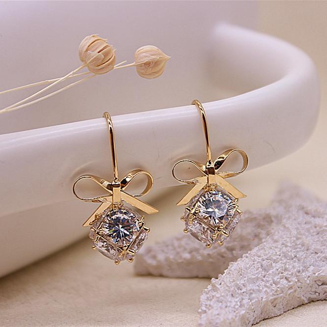 Ln bow round ball earrings inlaid with imitation diamond synthetic crystal earrings anti allergy Earrings Korean simple ears