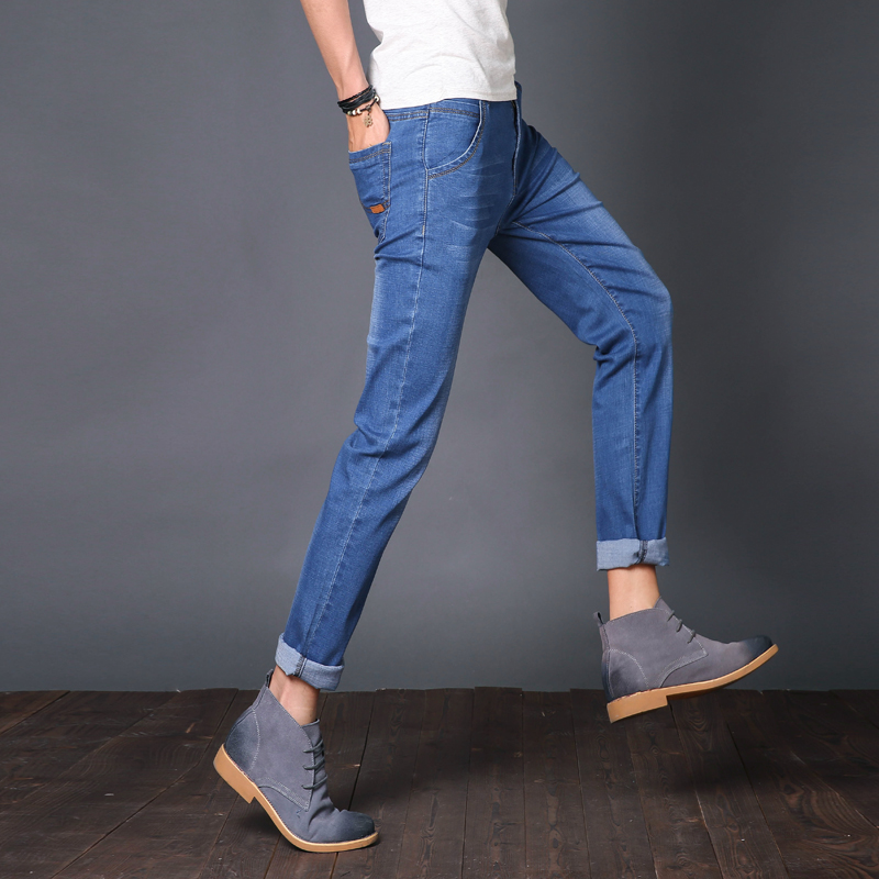 。 Spring thin mens slim light color jeans mens straight loose mens elastic summer casual jeans