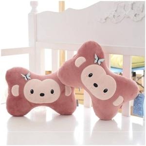 可爱豆豆猴汽车毛绒头枕护颈枕一对装卡通骨头枕靠枕车用枕头内。