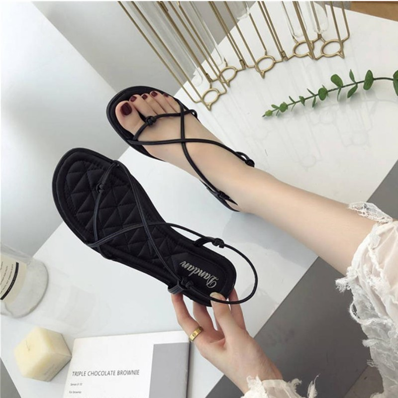 2020 new sandals women summer flat bottomed pinch feet Student Korean version versatile seaside holiday Roman beach shoes fairy style