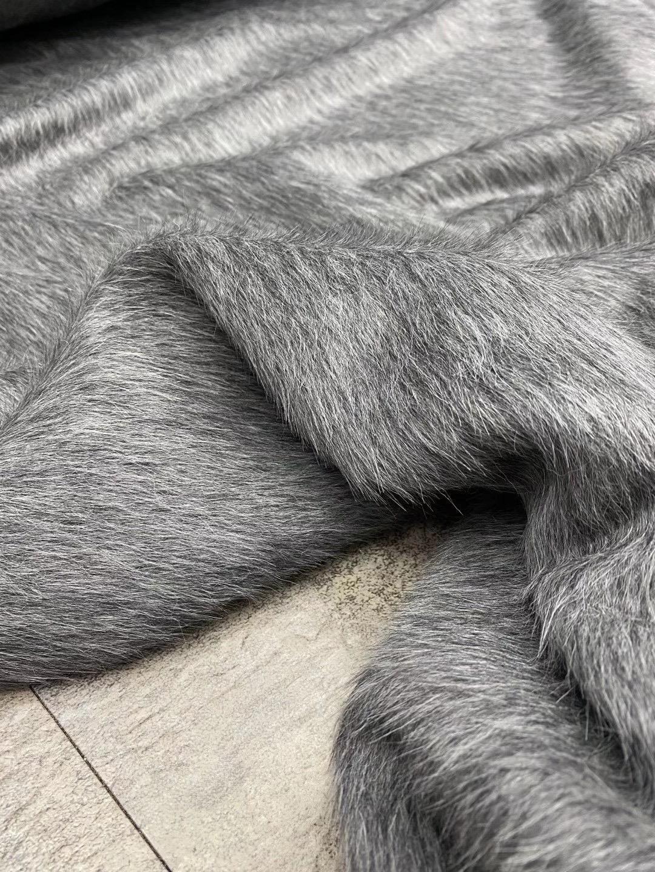 生地はペルーの贅沢な欧米の蘇力羊ラクダ毛のコートの高定片面の長い毛灰色の手製の服の布地です。