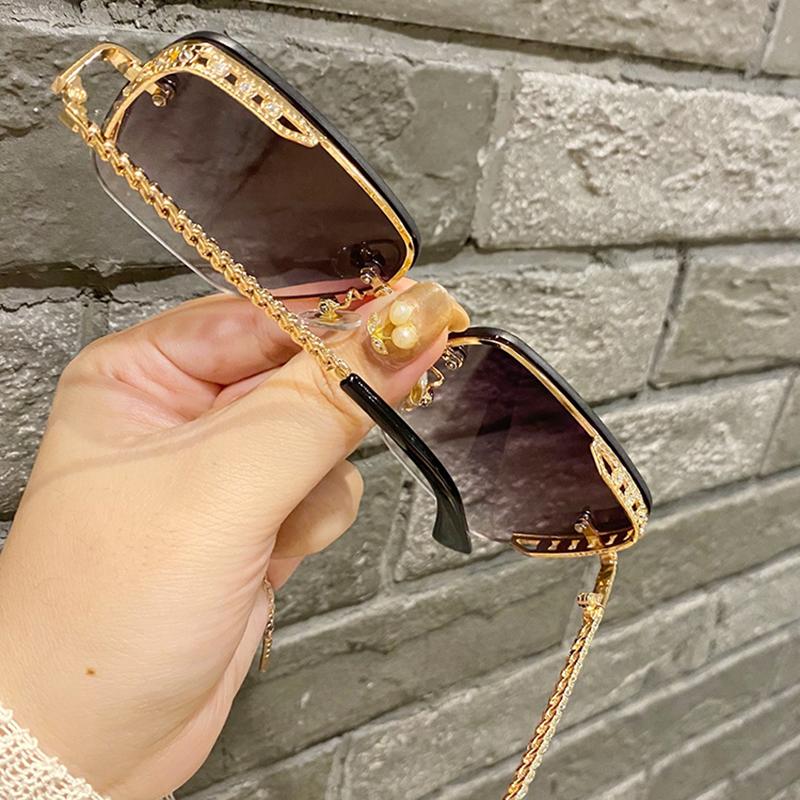 防大街茶色显潮女脸红新款无框瘦墨镜紫外线ins拍2020网太阳眼镜