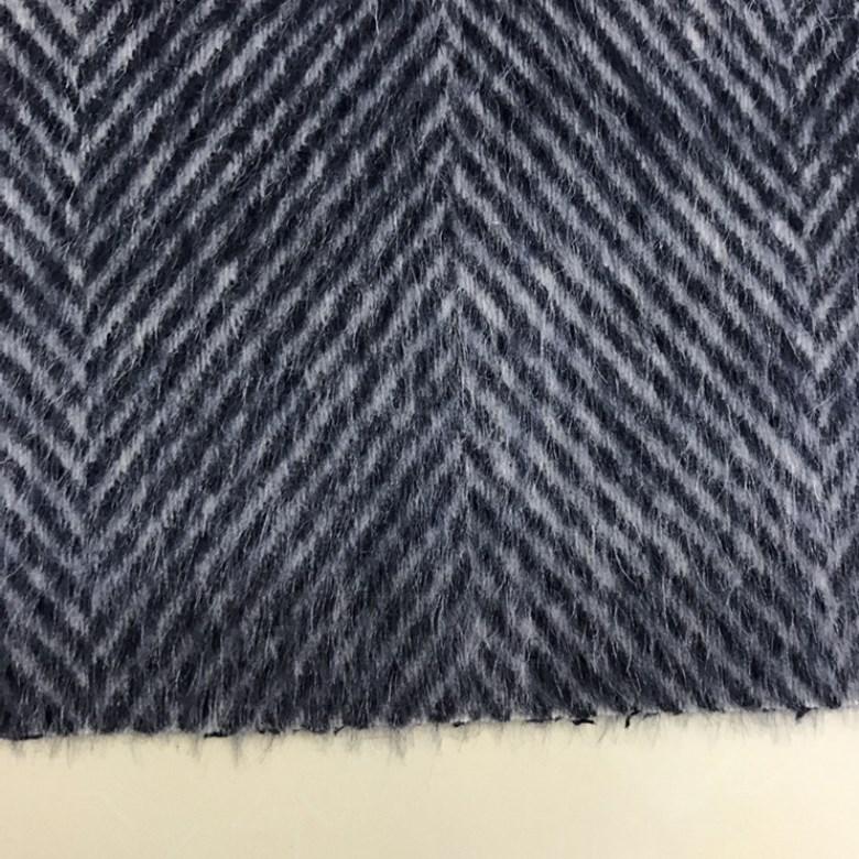 新商品の秋冬苏力羊ラクダ毛の両面のストライプの人字の長い毛の生地は、オーストラリアの毛のコートの服の布を厚くします。