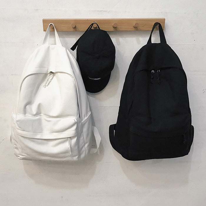 Simple pure color small fresh Canvas Backpack female Korean leisure junior high school student schoolbag male 2019 NEW
