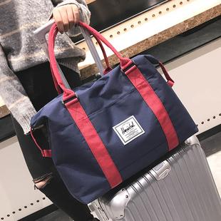 旅行出差帆布手提包大容量男士行李袋健身便携短途套拉杆女登机包图片