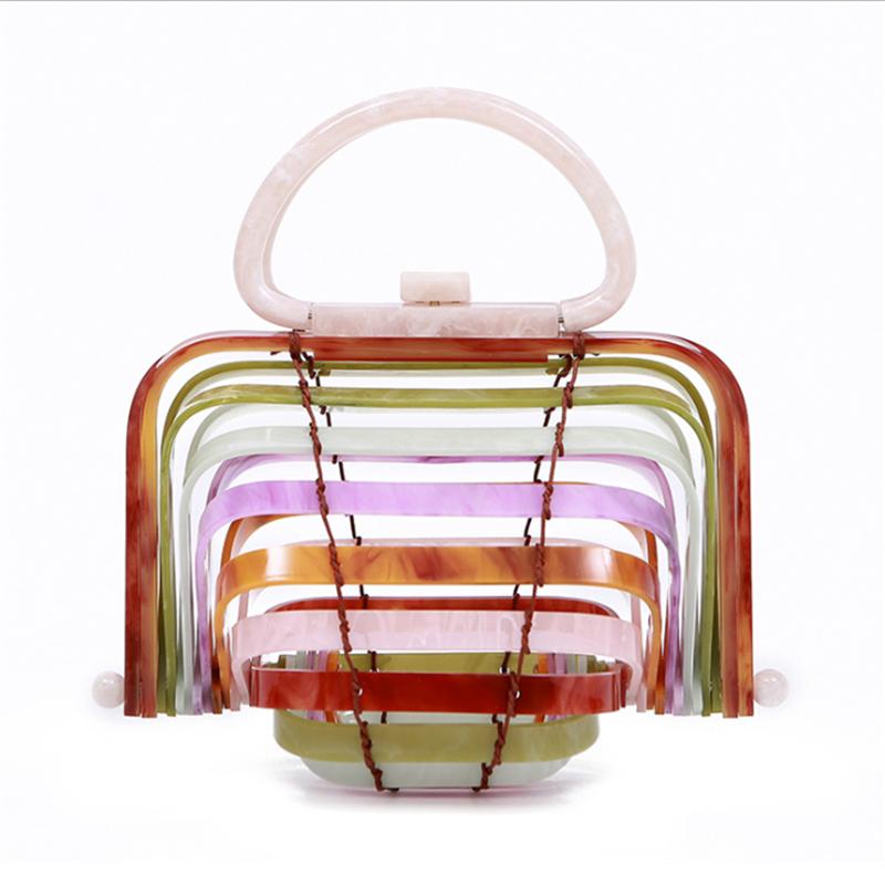アクリルバッグ女性2020新型リゾートビーチバッグ竹かごの透かしたハンドバッグ手作業折り貝殻バッグ