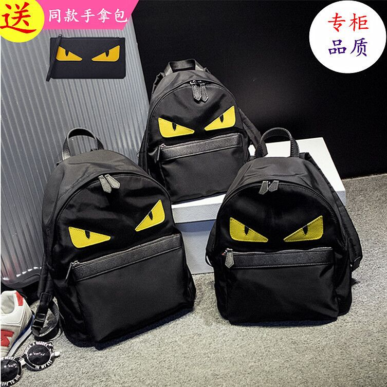 Authentic fashion yellow eyed monster backpack waterproof nylon oxford schoolbag for men and women